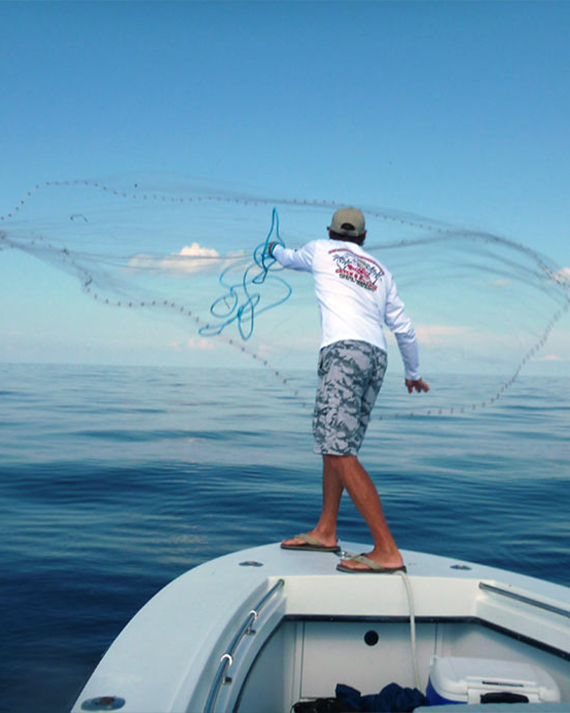 Captain Phil Throwing a Fishing Net | Fishing and Eco-Tour Charters in Fort Myers and Naples Florida - Pica Charters, LLC